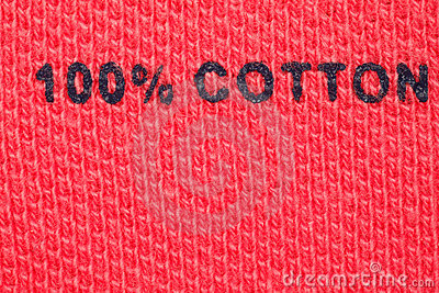 100  cotton - picture label on clothes. Close-up