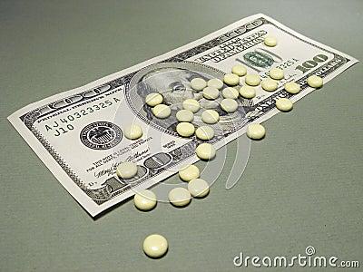 100 dólares e comprimidos