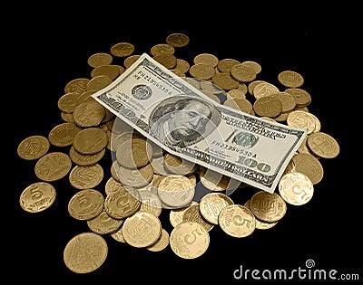 100 Dollar und viele goldenen Münzen