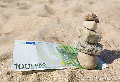 100 euro and stack of the stones.