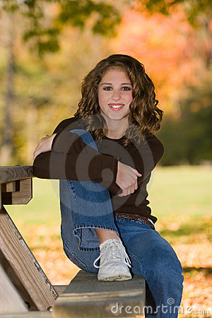 12 Year On Picnic Table Bench Under Tree In The Fall