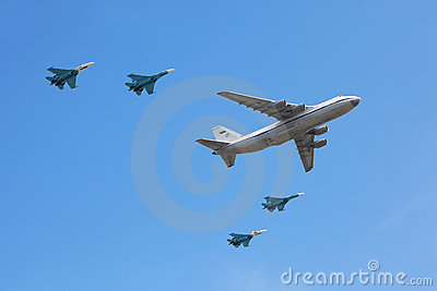 An-124 plane accompanied by group of Su-27 fighter Editorial Photography