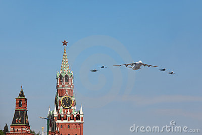 An-124 and Su-27 airplanes fly over Red Square Editorial Stock Image