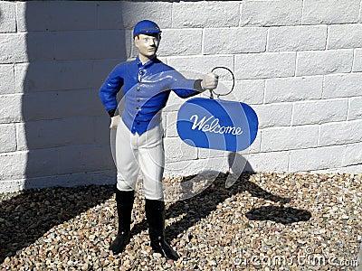 1950s: Blue lawn jockey welcome
