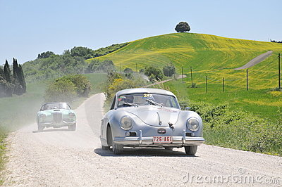 A 1955 Porsche and a 1955 green Lancia Aurelia Editorial Stock Photo