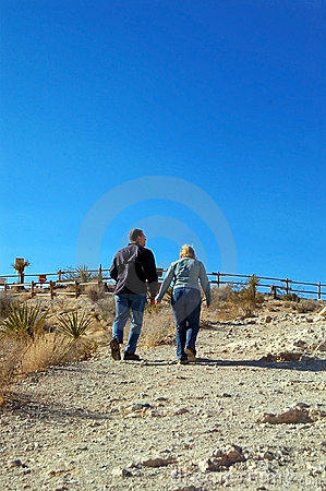2 adults walking up a path