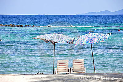 2 Chairs on beach in front of the sea
