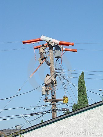 2 linemen on pole