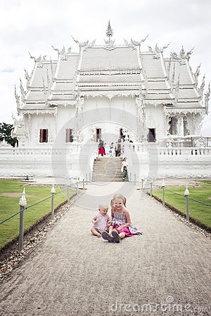 2 little girls (tourist) by Wat Rong Khun