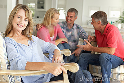 2 Mid age couples socialising at home
