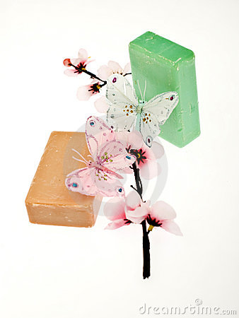 2 pieces of soap with 2 butterflys and a flower