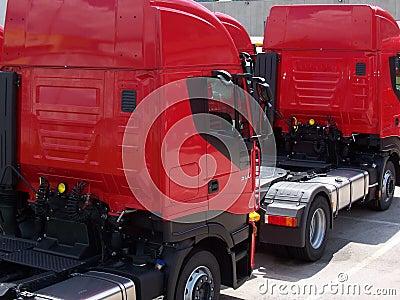 2 red trucks