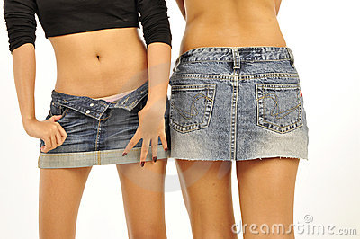 2 slim girls wearing short denim skirts