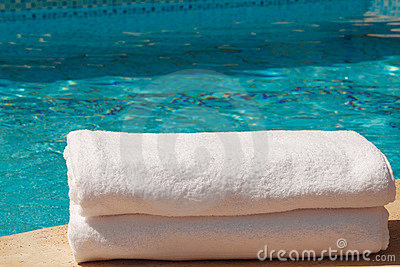 2 White towles by the pool
