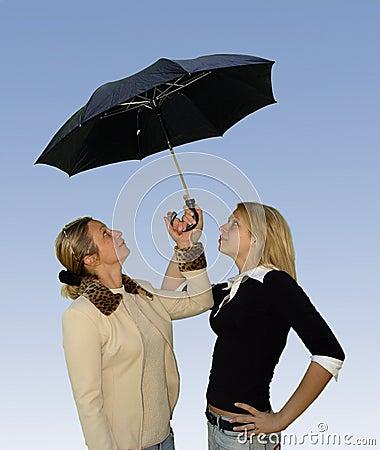2 women under the umbrella