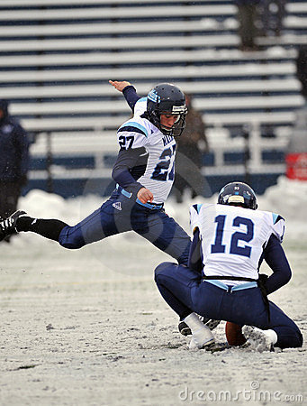 2011 NCAA Football - Kicking in the snow Editorial Photography