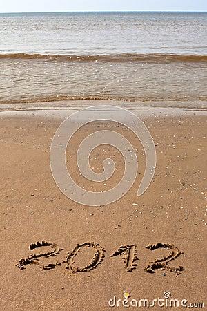 2012 Year written on the beach sand