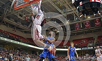 2013 NCAA Basketball - slam dunk from floor - wide angle