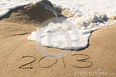 2013 in sand being covered by sea waves