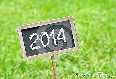 2014 on chalkboard on grass