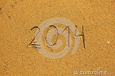 2014 escrito na areia na praia