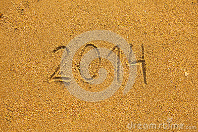 2014 written in sand on beach