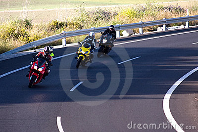 3 Bikers on curved road
