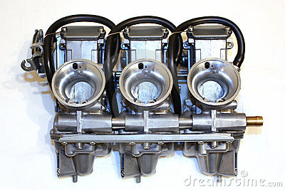 3 carburetors of a motorbike