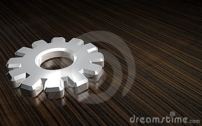 3-D metal gear on wood
