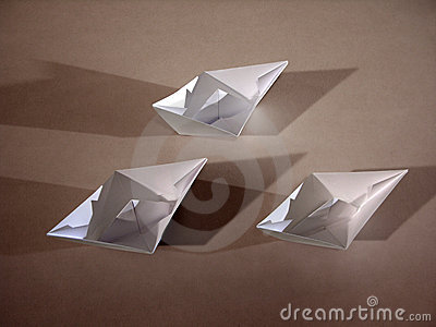3 paper boats on bronze Stock Photo
