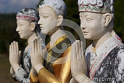 3 statues in luang namtha, laos