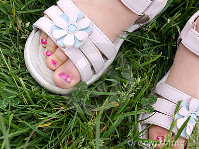 3 year old girl's pedicure in white dress sandals