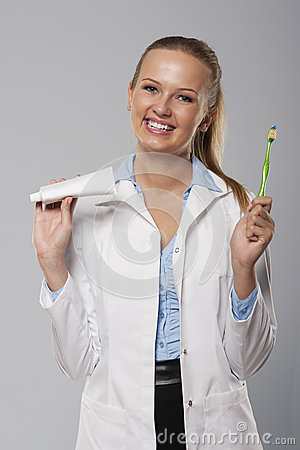http://thumbs.dreamstime.com/x/35569561http://www.dreamstime.com/stock-image-dentist-young-female-beautiful-smile-holding-toothbrush-toothpast-35569561.jpg