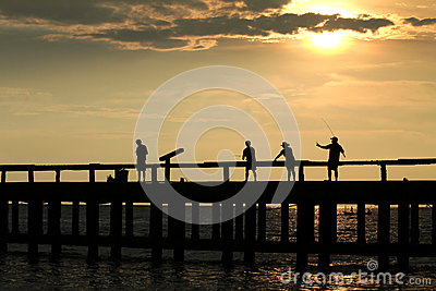 4 fisherman on jetty