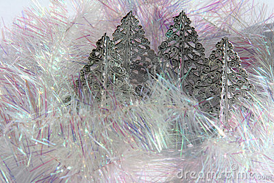 4 silver chrismas trees and pearl tinsel