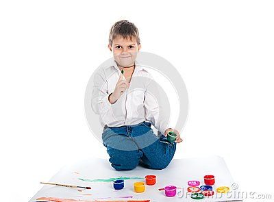 4 year old boy with  paint