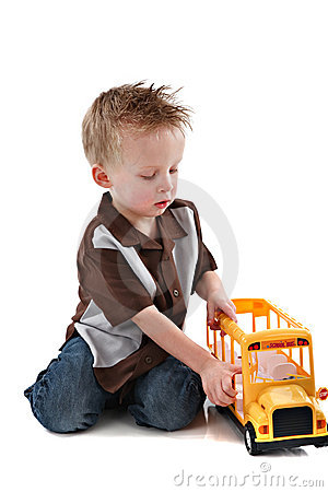 4 Year Old Boy Plying with Yellow School Bus Toy