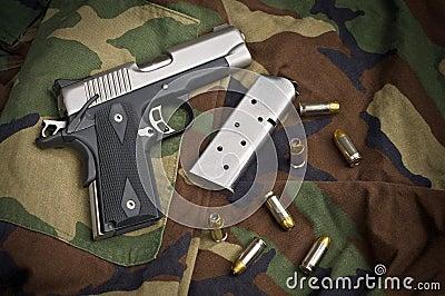 45 Firearm, Pistol Clip, Gun Ammunition on Camo