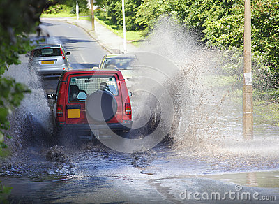 4x4 car driving through flood water