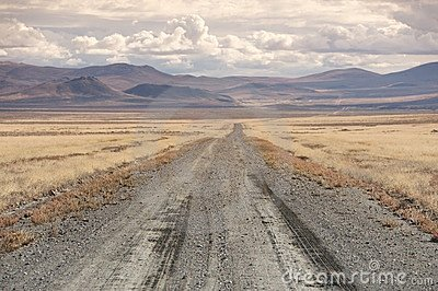 Dirt track stretches towards the horizon, Nevada,