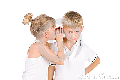 5-7 years old girl whispering to  boy