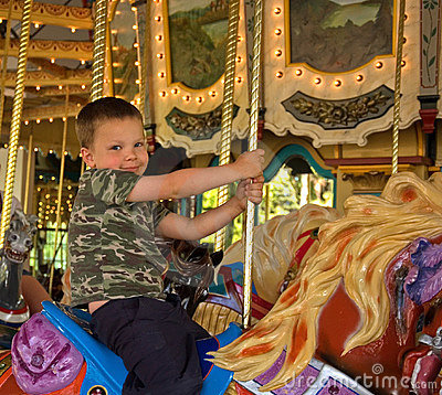 5 Year Old Boy on Carousel Horse