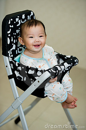 6 month old Asian baby girl smiling sweetly