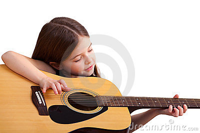 6 years old girl plays on the guitar