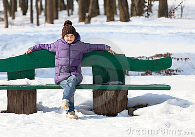 7 year old girl on a bench
