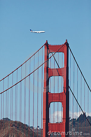 747 Flies over Golden Gate Bridge Editorial Stock Photo