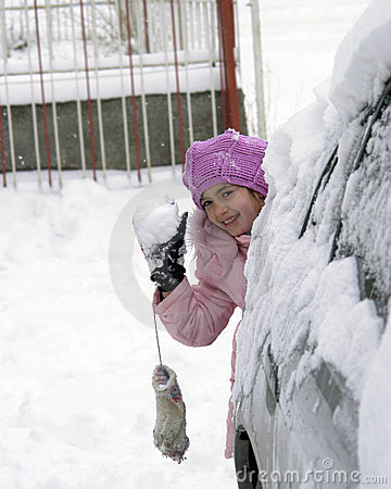 8 years old girl plays snowball