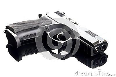 9 mm hand gun on glass table