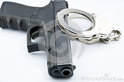 9-mm handgun automatic and police handcuff