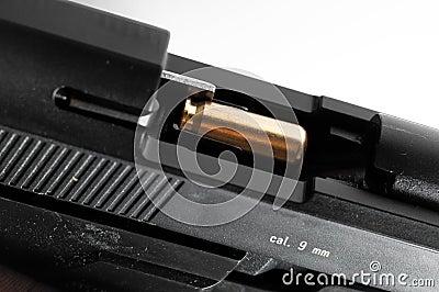 9mm handgun with bullet